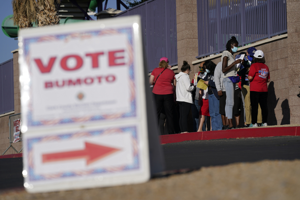 People wait in line to vote at a polling place on Election Day 2020 in Las Vegas. Republican efforts to restrict voting access are taking shape in statehouses across the country with a flurry of legislation aimed at limiting measures that led to record turnout in the 2020 presidential election. (AP Photo/John Locher, File)