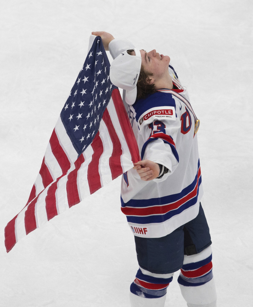 United States' Cole Caufield celebrates the team's win over Canada in the title game in the IIHF World Junior Hockey Championship, Tuesday night in Edmonton, Alberta.