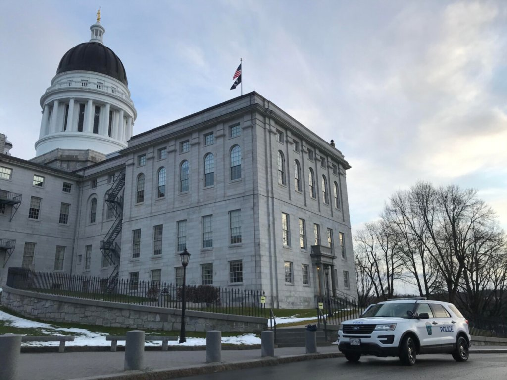 The scene outside Maine's State House was quiet Sunday morning. Aside from two Capitol police cruisers, the parking lot was mostly empty and no one was outside.