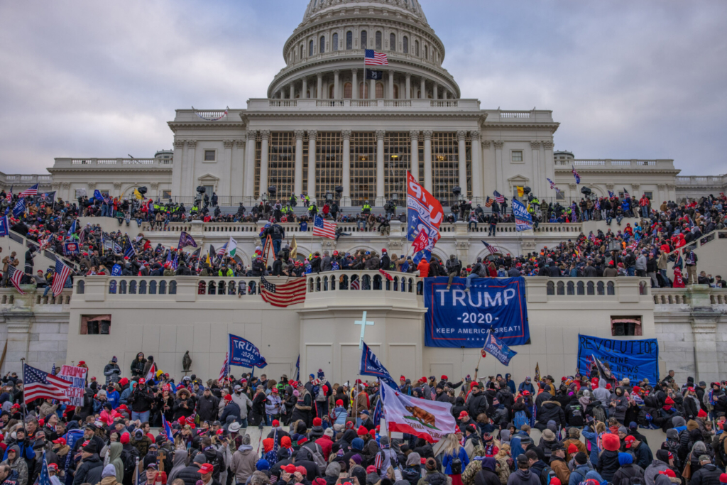 Supporters of President Trump mob the U.S. Capitol on Jan. 6. Five people died, including Capitol Police Officer Brian Sicknick, who was hit in the head with a fire extinguisher. A sixth person, another Capitol Police officer, later died by suicide.