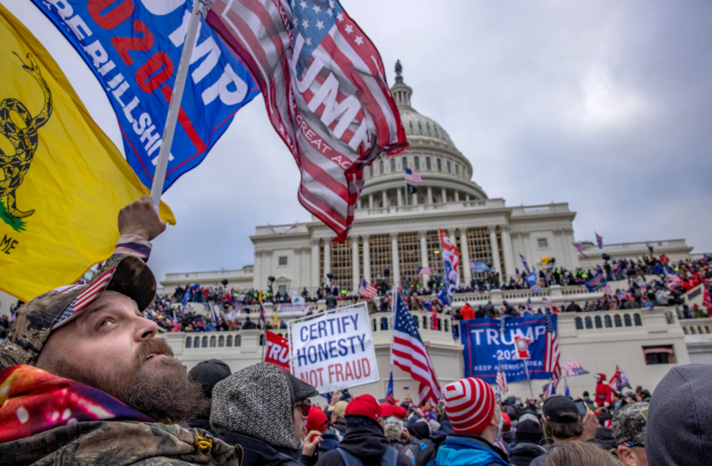 "Supporters of President  Trump storm the U.S. Capitol on Jan. 6. Many in Washington are concerned that riots will return around the inauguration Jan. 20. Airbnb announced Monday that it would be taking measures to keep hosts safe, including reviewing all upcoming reservations in ""the Washington, D.C. metropolitan area,"" canceling the bookings of guests associated with hate groups."