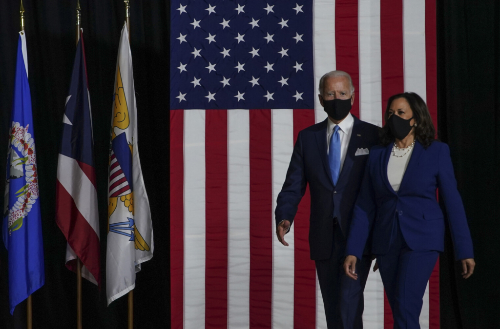 Joe Biden and Kamala Harris don masks during an August event in Wilmington, Del.