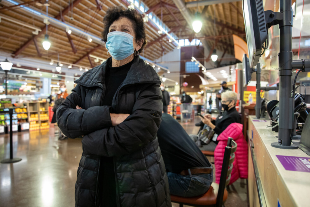 Ramona Cohen, 75, waits in line at a Giant grocery store in Washington, D.C. in the hope of getting a leftover dose of the coronavirus vaccine on Friday.