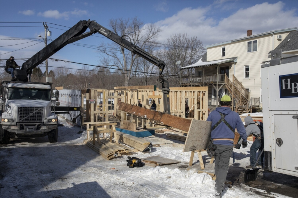 A crew works on framing the first floor of a multifamily building on Main Street in Westbrook on Feb. 11. Because of a zoning change to allow greater downtown density, developer Chris Wilson was able to add a third floor and double the number of apartments.