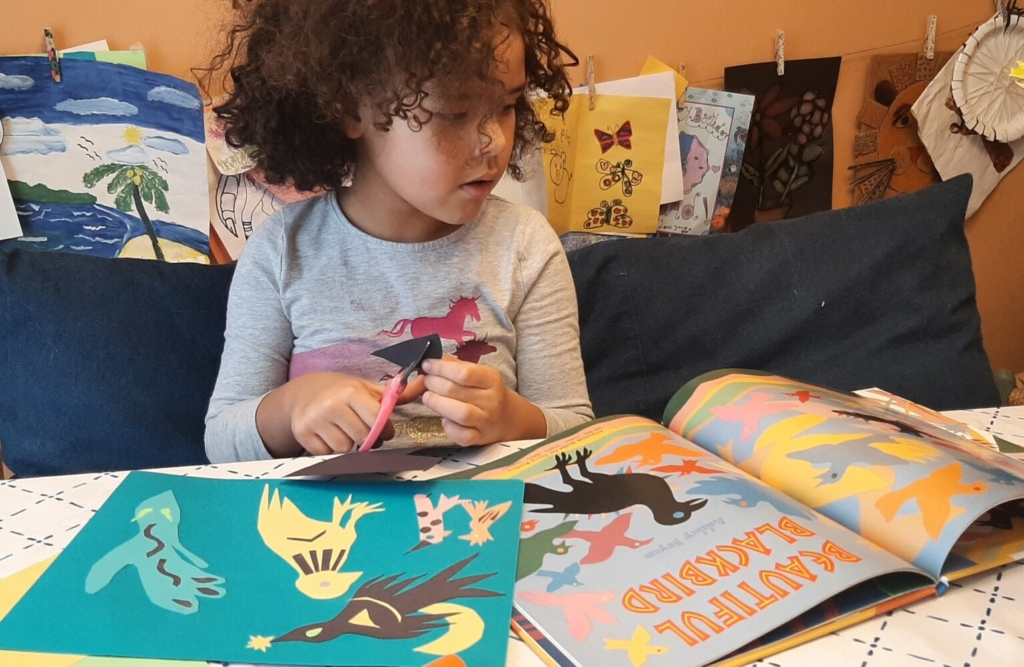 Four-year-old Naomi Shirley creates her Beautiful Blackbird-inspired collage from a special Art Kit for All to celebrate the artwork and legacy of Maine artist Ashley Bryan in honor of Black History Month.