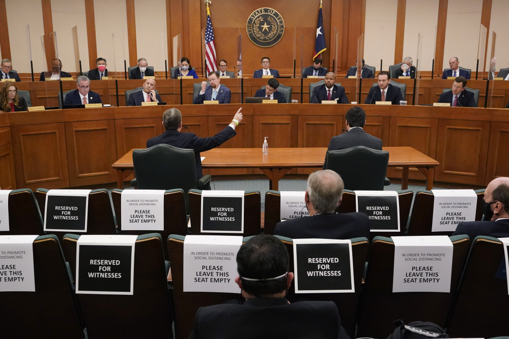 Curtis Morgan, the CEO of Vistra Corp., at table left, testifies as the Committees on State Affairs and Energy Resources holds a joint public hearing to consider the factors that led to statewide electrical blackouts, Thursday in Austin, Texas.