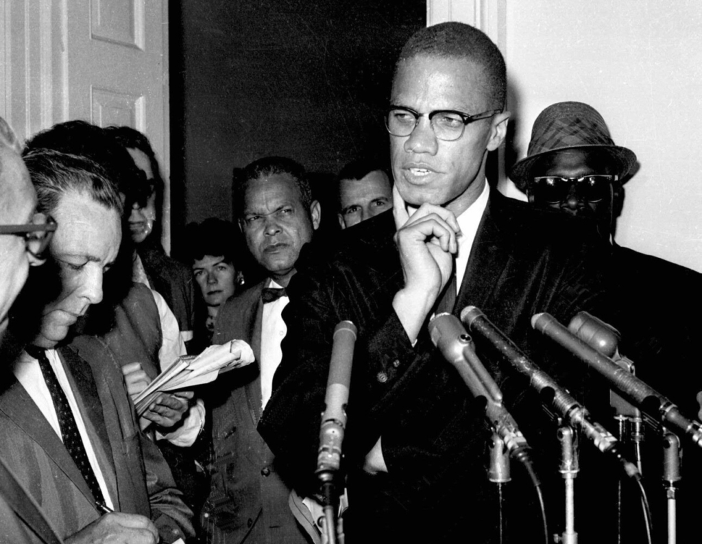 Civil rights leader Malcolm X speaks to reporters in Washington, D.C. on May 16, 1963. Sunday marked the 56th anniversary of his assassination.