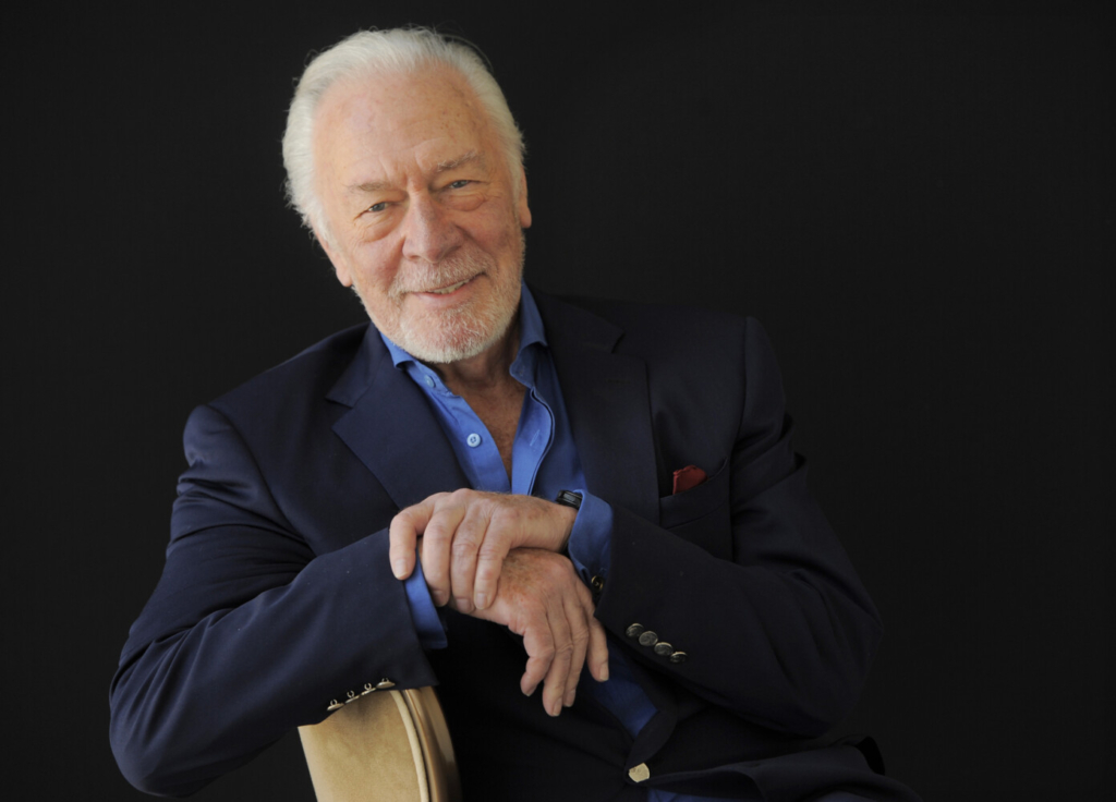 """Christopher Plummer poses for a portrait on July 25, 2013, in Beverly Hills, Calif. Plummer, the dashing award-winning actor who played Captain von Trapp in the film """"The Sound of Music"""" and at 82 became the oldest Academy Award winner in history, has died. He was 91. Plummer died Friday morning, Feb. 5, 2021, at his home in Connecticut with his wife, Elaine Taylor, by his side, said Lou Pitt, his longtime friend and manager."""