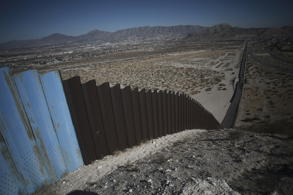 An older section of the border wall divides Ciudad Juarez, Mexico from Sunland Park, New Mexico, top, on the outskirts of Ciudad Juarez, Mexico, Tuesday, Jan. 12.