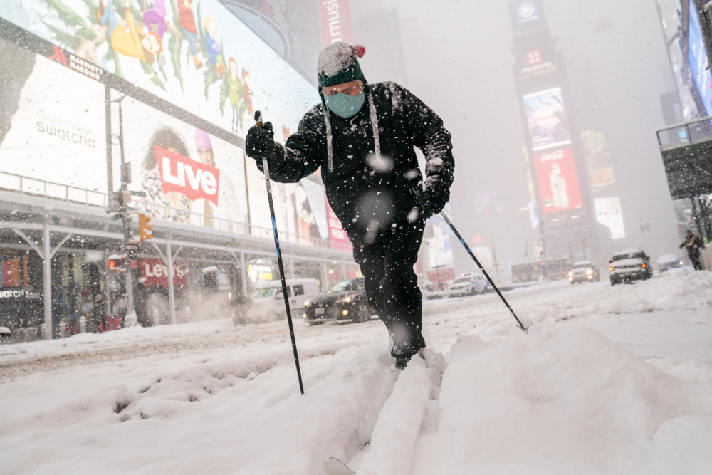 Steve Kent skis through Times Square during a snowstorm on Monday in the Manhattan borough of New York.