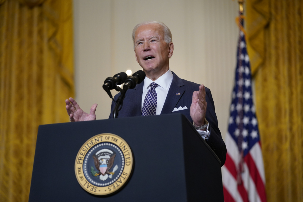"""President Biden speaks during a virtual event with the Munich Security Conference in the East Room of the White House on Friday in Washington. """"The United States is determined to reengage with Europe, to consult with you, to earn back our position of trusted leadership,"""" he told world leaders."""