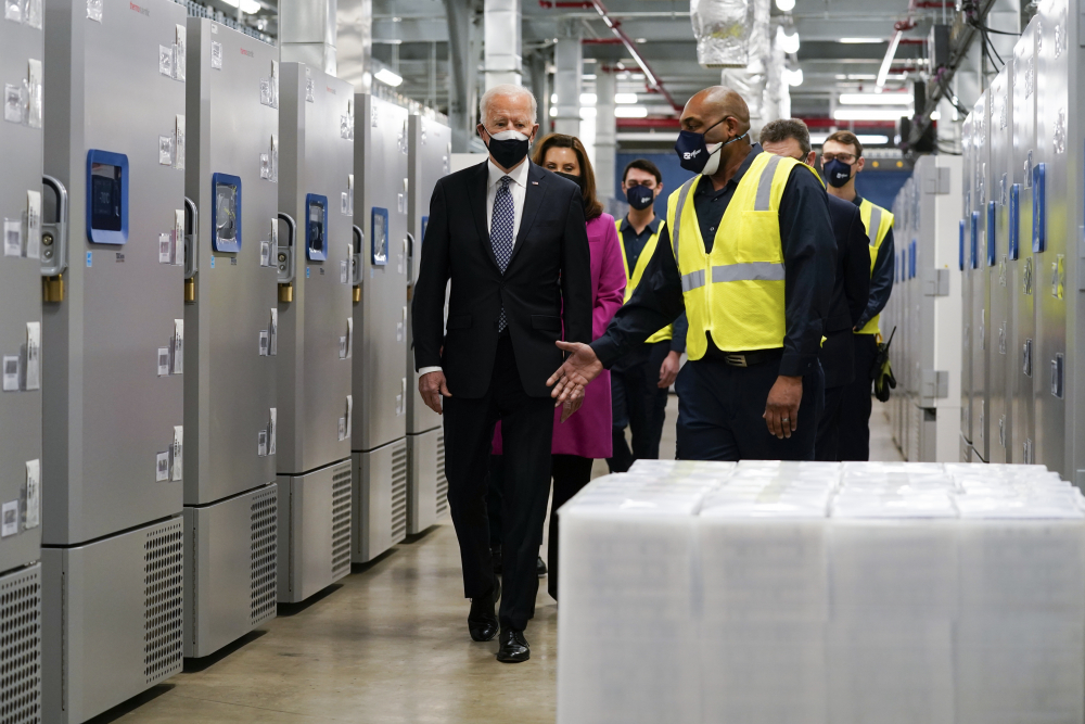 President Joe Biden tours a Pfizer manufacturing site, Friday, Feb. 19, in Portage, Mich.