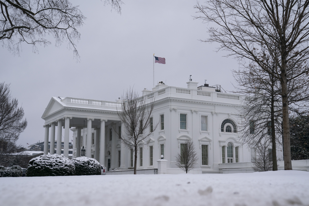 Snow covers the ground at the White House on Monday in Washington. President Biden was meeting Monday with 10 Republican senators about their alternative COVID-19 relief package.