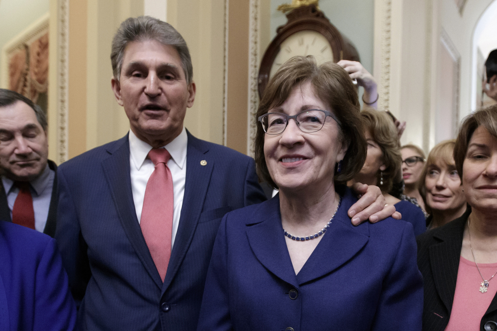 Sen. Susan Collins, R-Maine, and Sen. Joe Manchin, D-W.Va., shown in February, are leading informal talks to try to establish a commission to study the Jan. 6 insurrection at the Capitol.