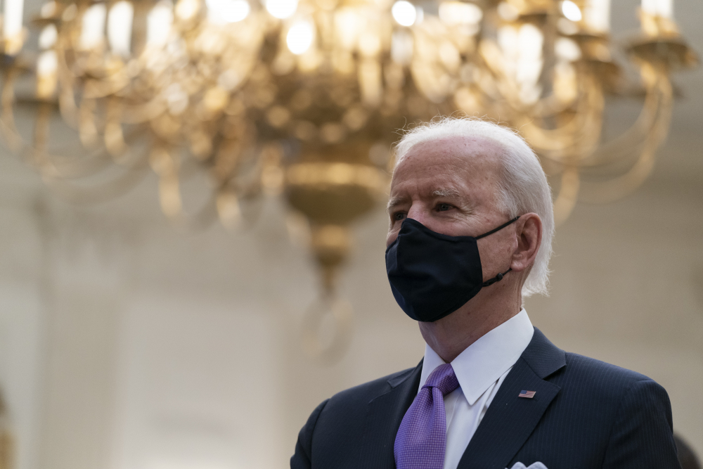 President Joe Biden stands during a performance of the national anthem on Jan. 21.