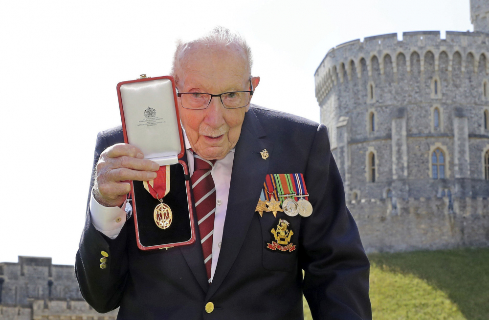 Captain Sir Thomas Moore poses for the media after receiving his knighthood from Britain's Queen Elizabeth, during a ceremony at Windsor Castle in Windsor, England on July 17.