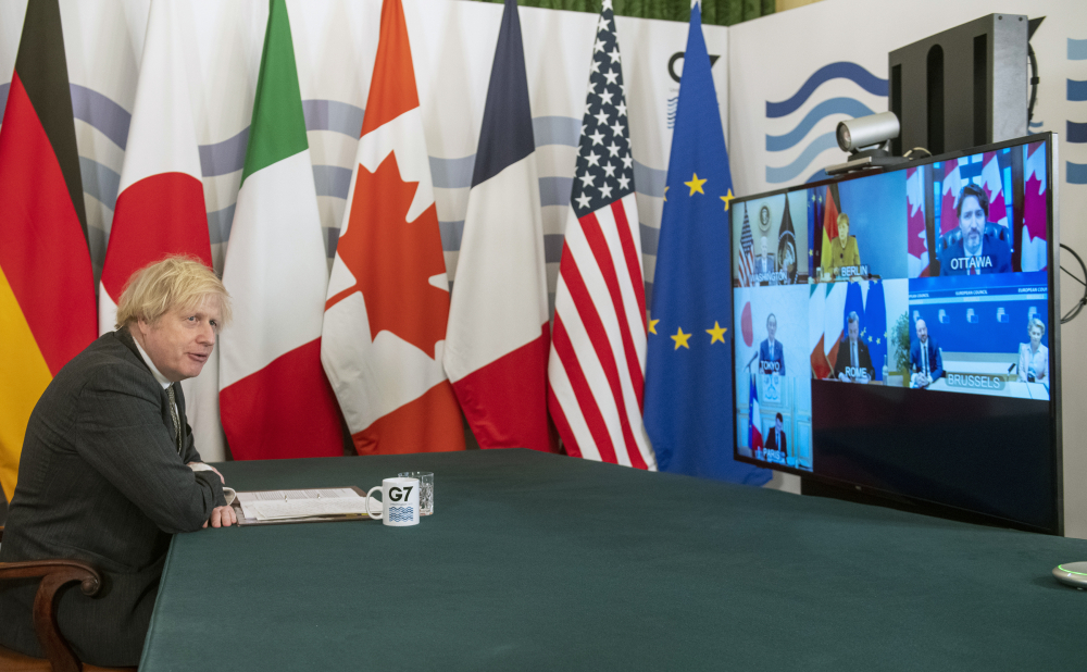 Britain's Prime Minister Boris Johnson hosts a virtual meeting of G7 world leaders, from within the Cabinet Room at Downing Street in London, Friday Feb. 19.