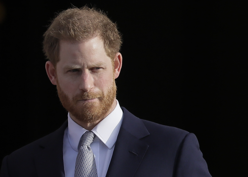 Britain's Prince Harry arrives in the gardens of Buckingham Palace in London in January 2020. Prince Harry has accepted an apology and damages from the publisher of British tabloid The Mail on Sunday and its online version, in a libel lawsuit relating to articles about his relationship with the British armed forces.