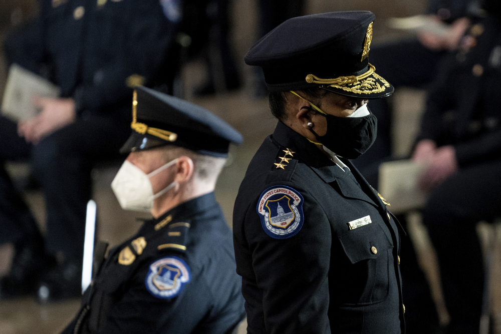 "Capitol Police Acting Chief Yogananda Pittman departs a ceremony memorializing U.S. Capitol Police officer Brian Sicknick in the Capitol Rotunda this month in Washington.  Pittman says the department faced ""internal challenges"" as it responded to the Jan. 6 riot."