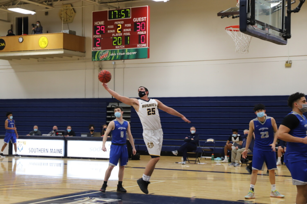 University of Southern Maine forward Marcus Christopher grabs a rebound during a game against the University of New England on Feb. 21 in  Gorham.