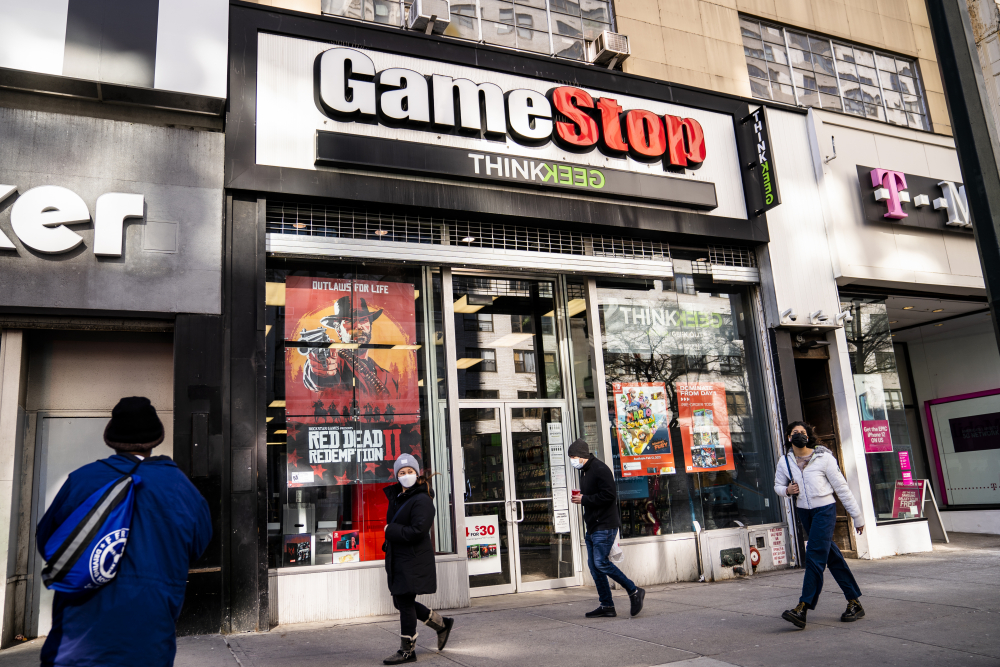 FILE - Pedestrians pass a GameStop store on 14th Street at Union Square, Thursday, Jan. 28, 2021, in the Manhattan borough of New York.  The GameStop saga has been portrayed as a victory of the little guy over Wall Street giants but not everyone agrees, including some lawmakers in Washington.  The House Financial Services Committee is ready to dig into the confounding episode at a hearing on Thursday, Feb. 18.  (AP Photo/John Minchillo, File)