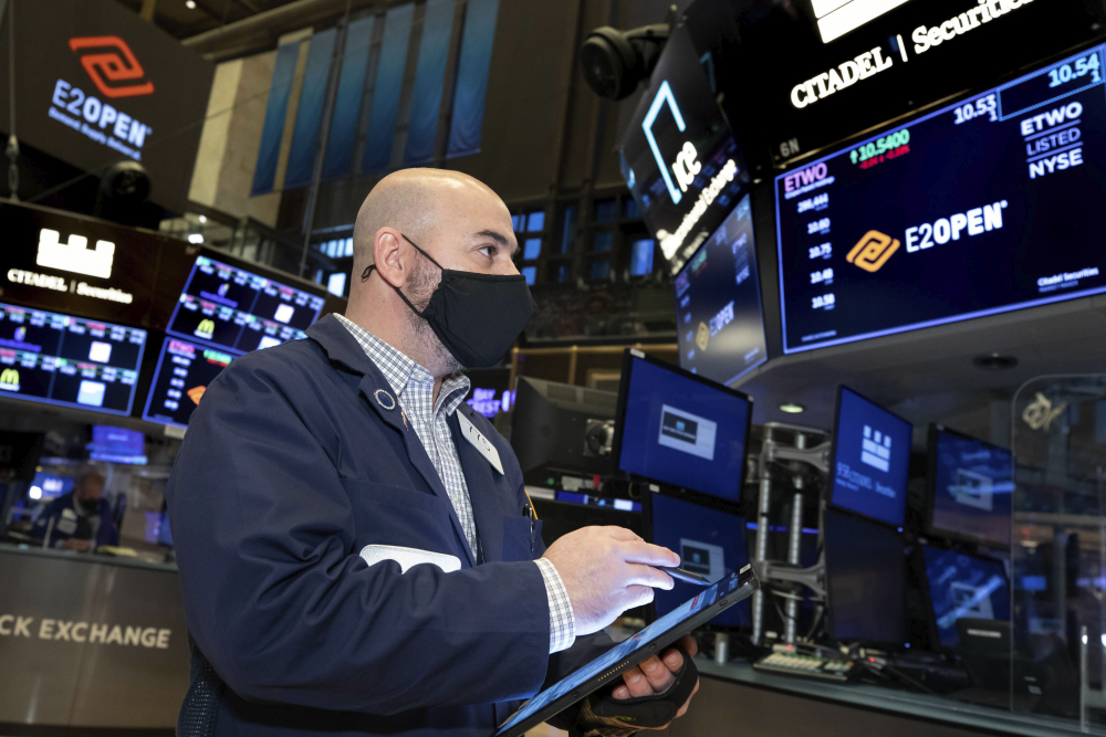 Trader Fred DeMarco works on the trading floor of the New York Stock Exchange on Monday.