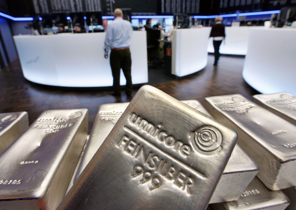 Silver futures jumped almost 12 percent on Monday to over $30 per ounce, overwhelming coin dealers.