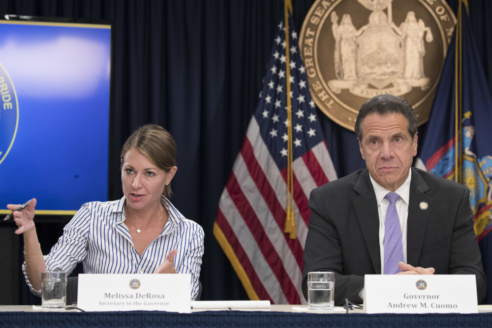 """Secretary to the Governor Melissa DeRosa is joined by New York Gov. Andrew Cuomo as she speaks to reporters during a news conference in New York in 2018. De Rosa, Cuomo's top aide, told top Democrats frustrated with the administration's long-delayed release of data about nursing home deaths that the administration """"froze"""" over worries about what information was """"going to be used against us,"""" according to a Democratic lawmaker who attended the Wednesday meeting and a partial transcript provided by the governor's office."""