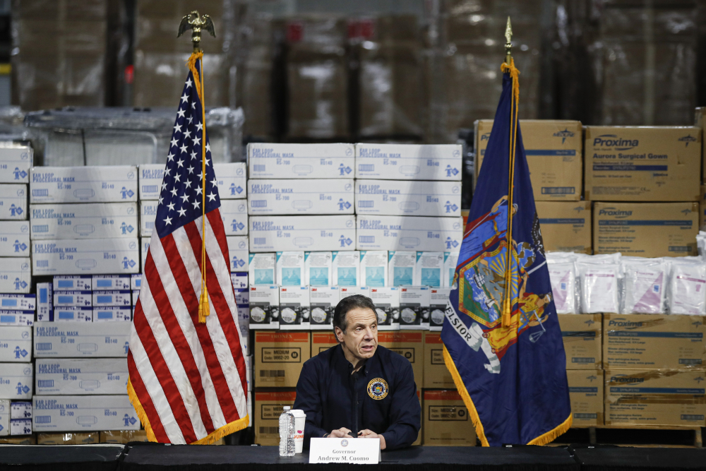 Gov. Andrew Cuomo speaks during a news conference against a backdrop of medical supplies March 24 in New York.