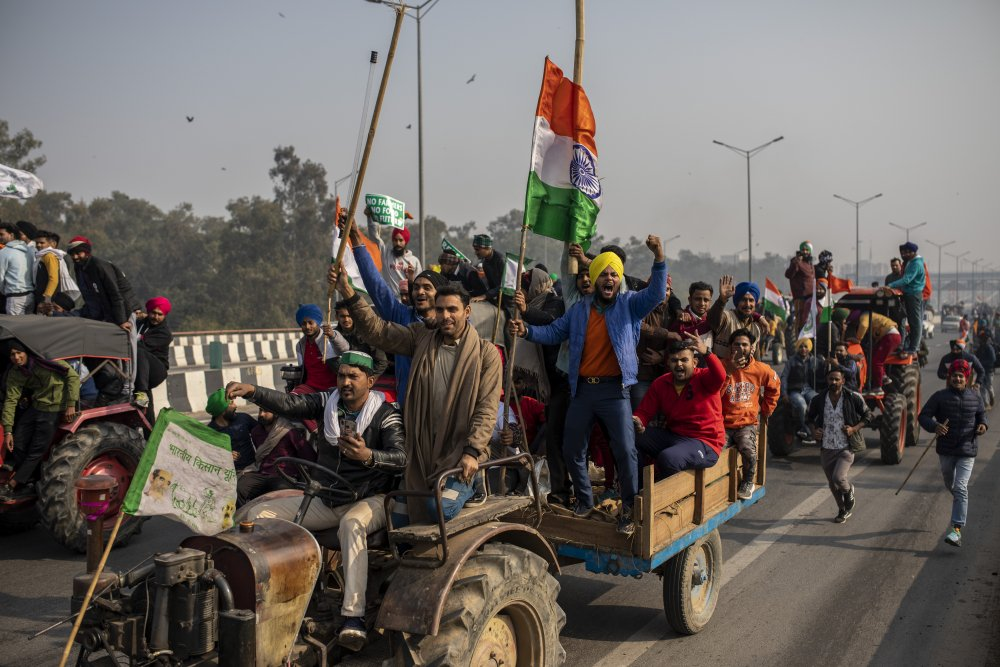 Protesting farmers  march to the capital during India's Republic Day celebrations in New Delhi, India, on Jan. 26. Farmers are increasingly worried about their livelihoods under laws they believe would end guaranteed pricing and force them to sell to powerful corporations rather than government-run markets.