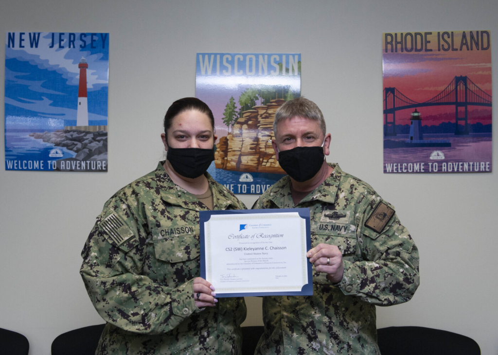 New London Chaplain Cmdr. Jamie Stall-Ryan presents Culinary Specialist 2nd Class Kieleyanne Chaisson with a certificate of recognition from the Chamber of Commerce of Eastern Connecticut for her selection as Service Person of the Month for January.