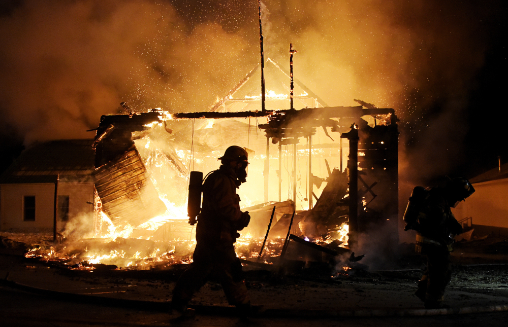 Firefighters work the scene of a fire at the Town Hall building in Jefferson, N.H. on Monday night. (Paul Hayes/Caledonian-Record via AP)