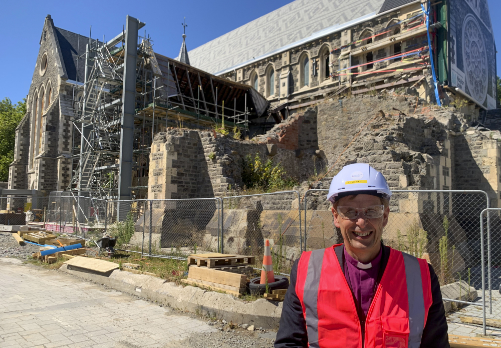 Peter Carrell, the Anglican bishop of Christchurch, stands outside the 2011 earthquake damaged Christ Church Cathedral in central Christchurch, New Zealand on Feb 11.