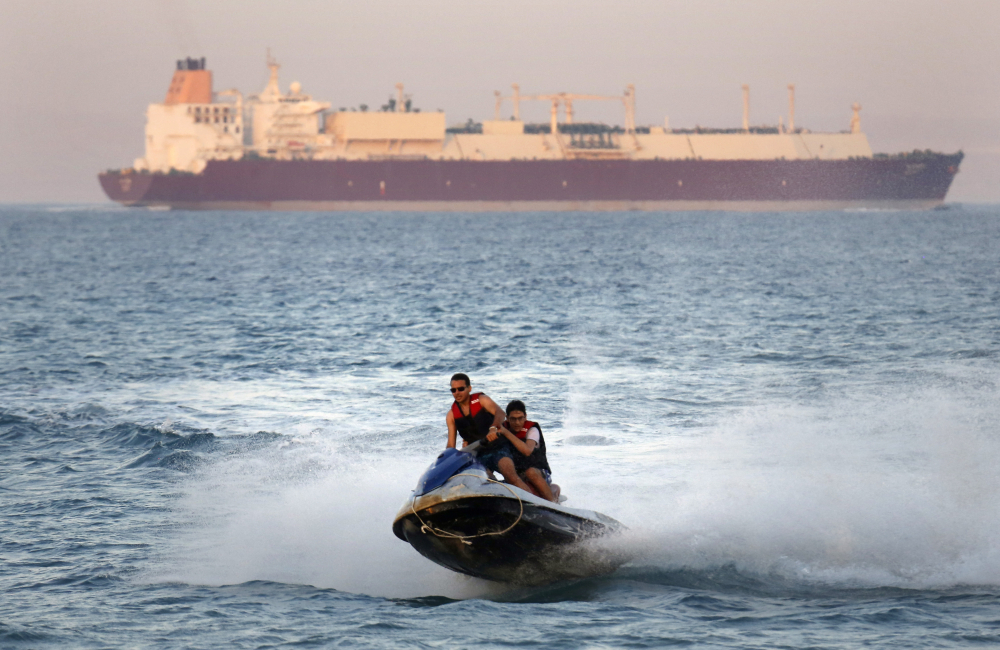 A ship crosses the Gulf of Suez toward the Red Sea as holiday-makers ride a jet ski at al Sokhna beach in Suez, 79 miles east of Cairo, Egypt, in 2019. Not only are humans changing the surface and temperature of the planet, but also its sounds – and those shifts are detectable even in the open ocean, according to research published Thursday.