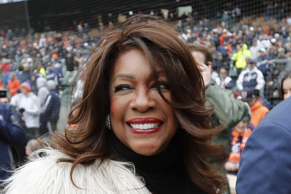 In this April 4, 2019, file photo, Mary Wilson, one of the original members of The Supremes, is escorted after singing the national anthem before a baseball game between the Detroit Tigers and the Kansas City Royals in Detroit. Wilson died in Las Vegas, publicist Jay Schwartz told KABC-TV. She was 76.
