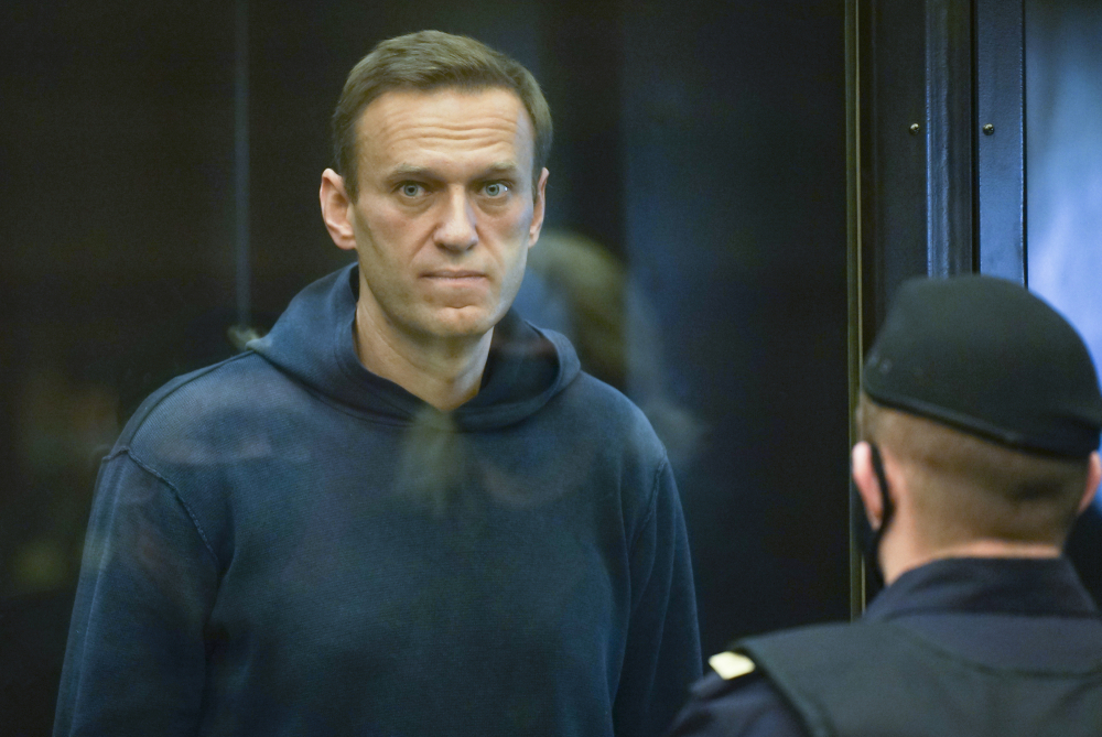 In this handout photo provided by Moscow City Court Russian opposition leader Alexei Navalny stands in the cage during a hearing on a motion from the Russian prison service to convert his suspended sentence  from the 2014 criminal conviction into a real prison term in the Moscow City Court in Moscow, Russia, on Tuesday.