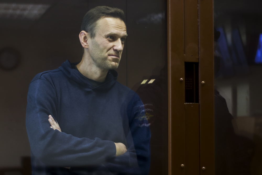 In this photo provided by the Babuskinsky District Court, Russian opposition leader Alexei Navalny stands in a cage during a hearing on his charges for defamation, in the Babuskinsky District Court in Moscow, Russia, Friday, Feb. 5.