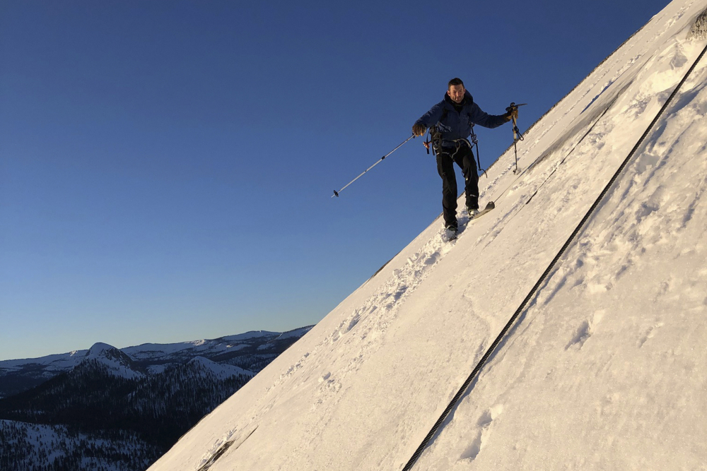 Zach Milligan descends down Half Dome in Yosemite on Feb.  21.