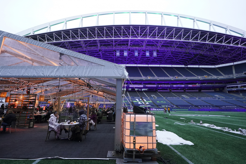 People eat dinner in an outdoor dining tent set up at Lumen Field, the home of the Seattle Seahawks NFL football team, on Feb. 18.