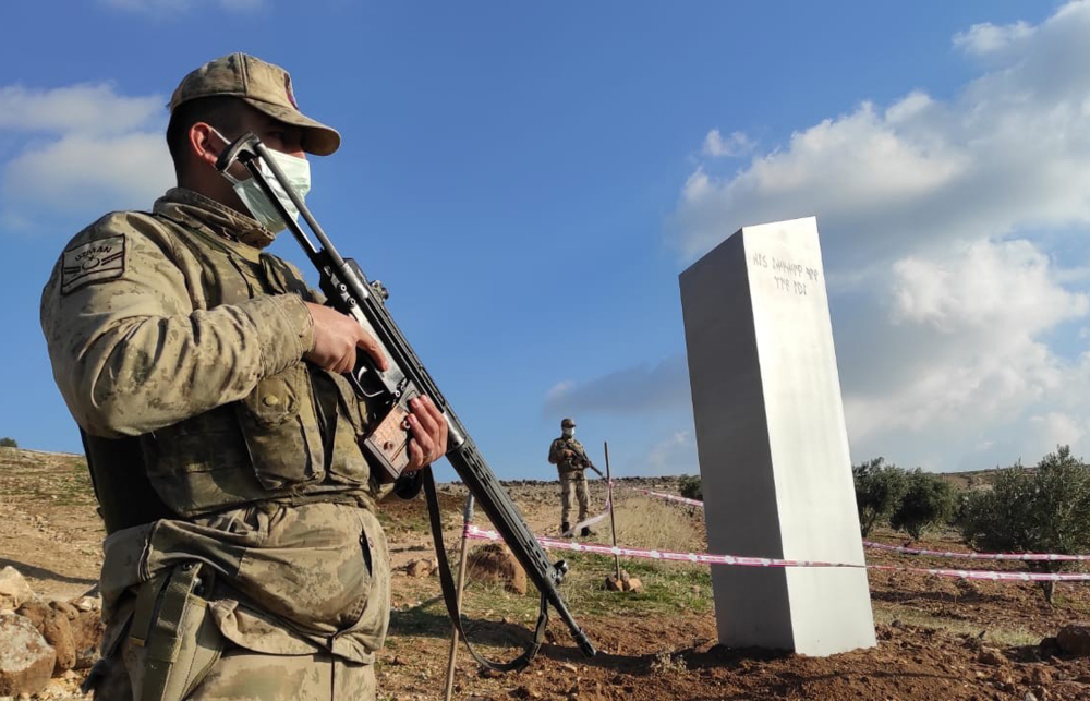Turkish police officers guard a monolith found in a field near Sanliurfa, southeastern Turkey, on Sunday.