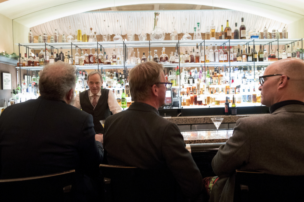 A bartender talks to a customer at the Gotham Bar and Grill on Nov. 27, 2018, in New York. The Manhattan upscale restaurant hopes to reopen by summer 2021 if government regulations permit, but will likely have just 35 staffers instead of the 100 the restaurant had before it closed in March 2020.