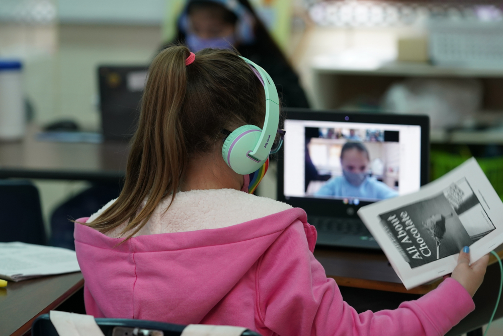 Students at Driggers Elementary School attend a class in person as they interact with classmates virtually on Monday in San Antonio.