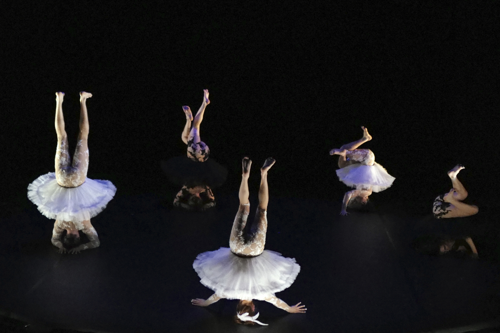 """Dancers perform """"Le Lac des Cygnes"""" by Florence Caillon, based on Tchaikovsky's Swan Lake during the BIAC, International Circus Arts Biennale, in Marseille, south of France, on Thursday."""