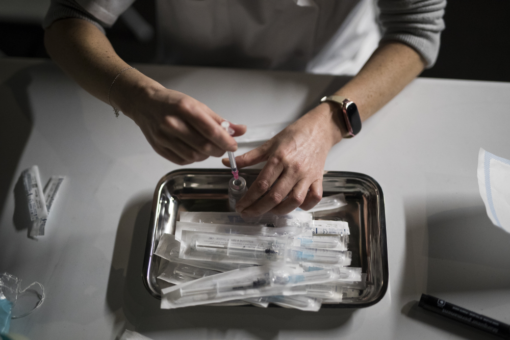 Nurse Coralie Ferron prepares doses of the Moderna COVID-19 vaccine at a vaccination center in Le Cannet, southern France on Jan. 21. France's highest health authority, the High Authority of Health, or HAS, recommended Friday Feb. 12, 2021, that people who have had COVID-19 receive only one dose of a vaccine against the coronavirus.