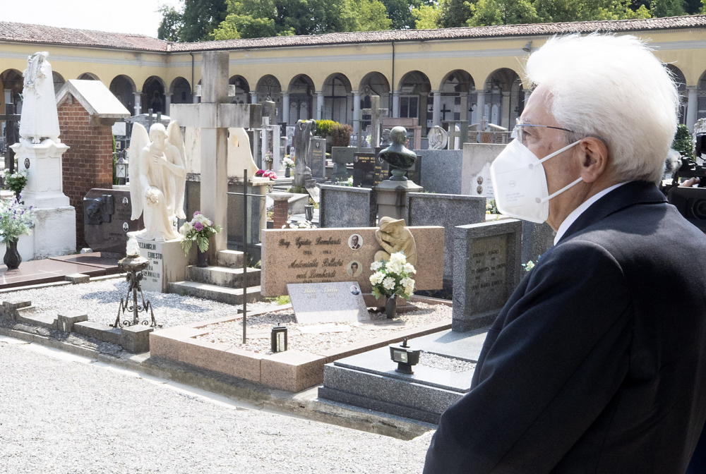 Italian President Sergio Mattarella stands silent June 2 in front of graves at the cemetery of Codogno, Italy, where the first case of COVID-19 emerged.