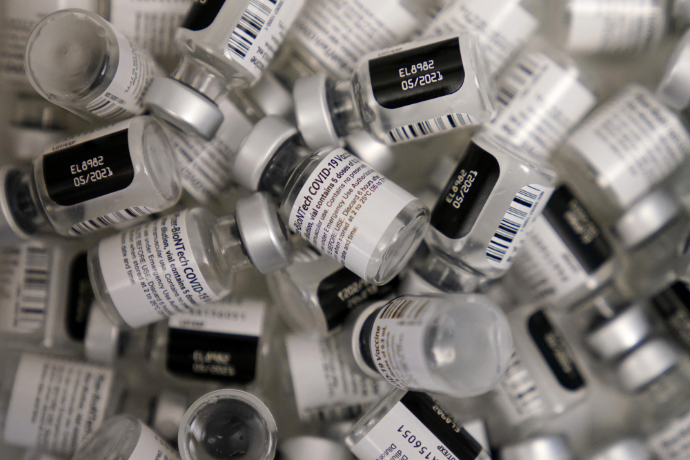 "Empty vials of the Pfizer-BioNTech COVID-19 vaccine are seen at a vaccination center in Las Vegas. With virus mutations on the rise, experts are questioning if the vaccine needs to be modified or not. If fully immunized people start getting hospitalized with mutated virus, ""that's when the line gets crossed,"" said Dr. Paul Offit, a Children's Hospital of Philadelphia vaccine expert who advises the FDA."