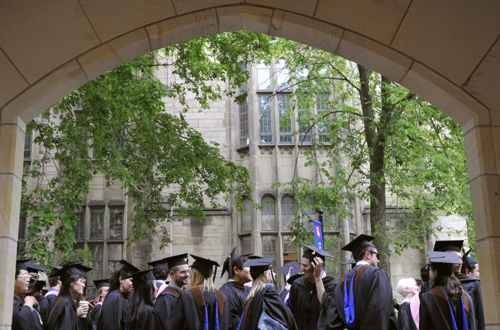 Future graduates wait for the procession to begin for commencement at Yale University in New Haven, Conn. in 2010. The Biden Justice Department says it is dismissing its discrimination lawsuit against Yale University. The Trump administration alleged last year that the university was illegally discriminating against Asian American and white applicants.