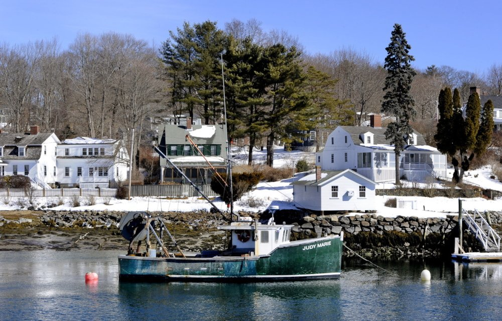 A lobster boat floats in the York River, which is used by commercial and recreational fishermen. The river flows from York Pond past farm fields and salt marshes to York Harbor, touching York, Kittery, South Berwick and Eliot.