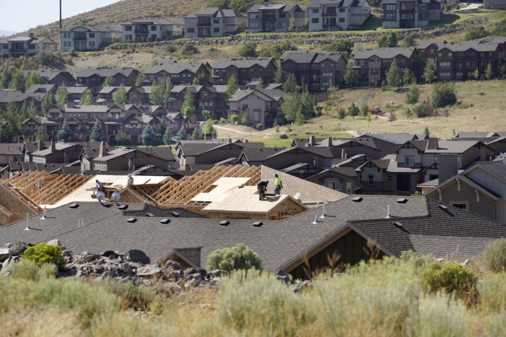Contractors frame the roof of a home under construction in Park City, Utah, on Aug. 14, 2020. Median home sale prices in the city spiked by more than 50 during the summer, according to Sotheby's.