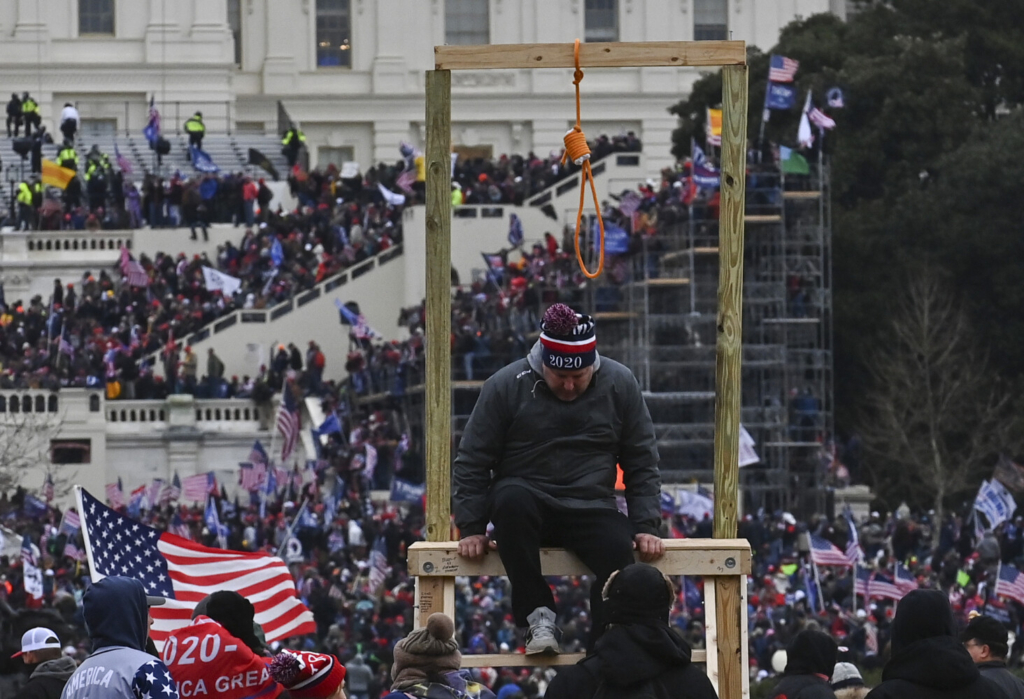 A man climbs down after being photographed with a noose at the U.S. Capitol on Jan. 6. 2021. MUST CREDIT: Washington Post photo by Ricky Carioti